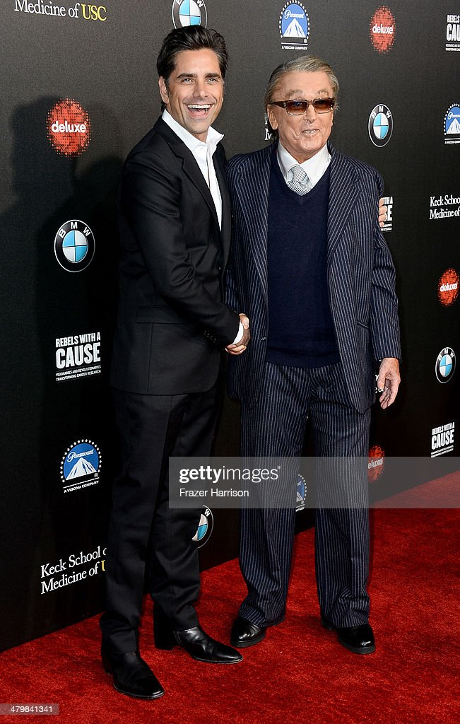Actor John Stamos and producer Robert Evans arrive at the 2nd Annual Rebels With A Cause Gala at Paramount Studios on March 20 2014 in Hollywood...