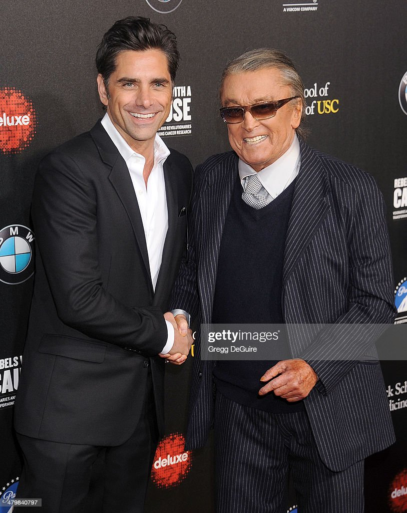 Actor John Stamos and Robert Evans arrive at the 2nd Annual Rebel With A Cause Gala at Paramount Studios on March 20 2014 in Hollywood California