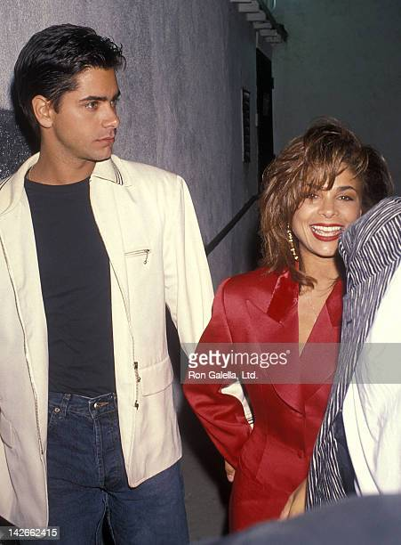 Actor John Stamos and singer Paula Abdul attend Milton Berle's 82nd Birthday Party on July 13 1990 at The Improv in West Hollywood California