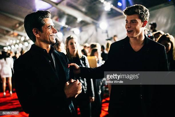 Actor John Stamos and singer Shawn Mendes attend the People's Choice Awards 2016 at Microsoft Theater on January 6 2016 in Los Angeles California