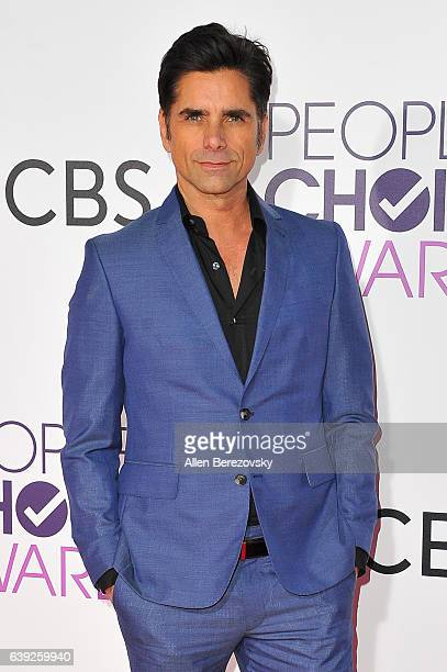 Actor John Stamos arrives at People's Choice Awards 2017 at Microsoft Theater on January 18 2017 in Los Angeles California