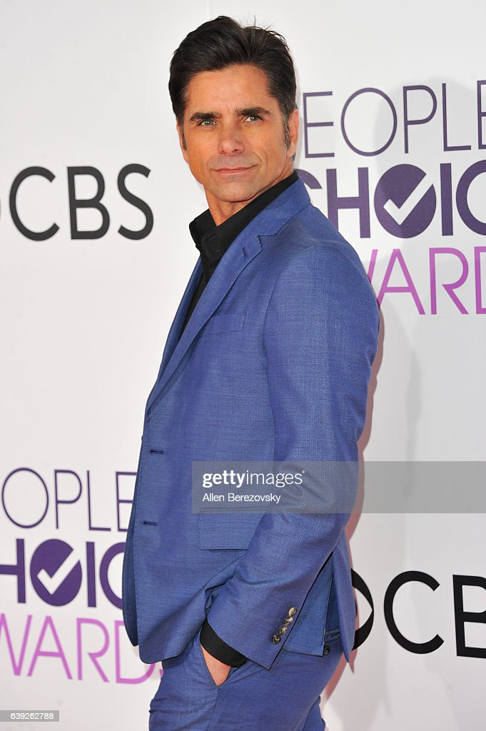 Actor John Stamos arrives at People's Choice Awards 2017 at Microsoft Theater on January 18, 2017 in Los Angeles, California.