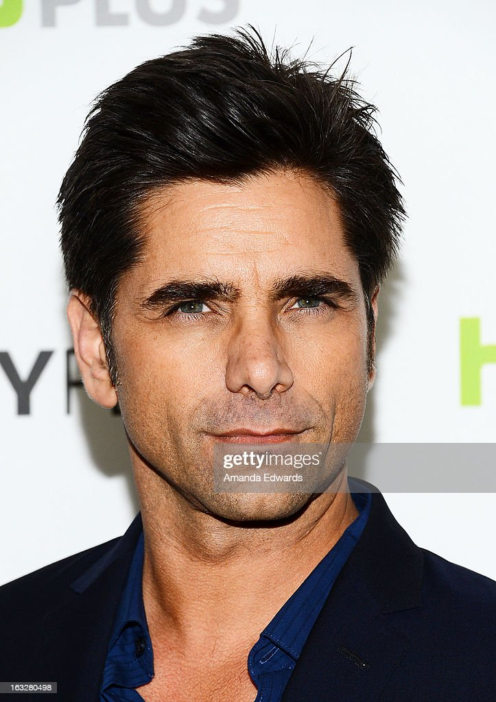 Actor <a gi-track='captionPersonalityLinkClicked' href=/galleries/search?phrase=John+Stamos&family=editorial&specificpeople=206285 ng-click='$event.stopPropagation()'>John Stamos</a> arrives at the 30th Annual PaleyFest: The William S. Paley Television Festival featuring 'The New Normal' at the Saban Theatre on March 6, 2013 in Beverly Hills, California.