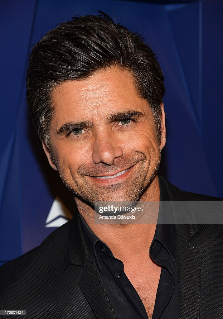 Actor <a gi-track='captionPersonalityLinkClicked' href=/galleries/search?phrase=John+Stamos&family=editorial&specificpeople=206285 ng-click='$event.stopPropagation()'>John Stamos</a> arrives at the Delta Air Lines Summer Celebration at Beverly Grove Drive on August 15, 2013 in Beverly Hills, California.