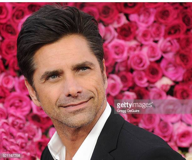 Actor John Stamos arrives at the Open Roads World Premiere Of 'Mother's Day' at TCL Chinese Theatre IMAX on April 13 2016 in Hollywood California