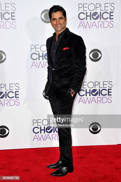 Actor John Stamos arrives at the People's Choice Awards 2016 at Microsoft Theater on January 6 2016 in Los Angeles California