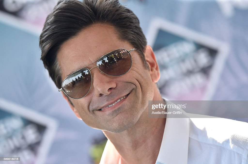 Actor John Stamos arrives at the Teen Choice Awards 2016 at The Forum on July 31 2016 in Inglewood California