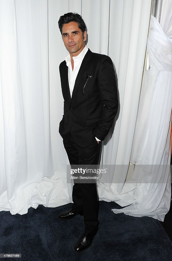Actor <a gi-track='captionPersonalityLinkClicked' href=/galleries/search?phrase=John+Stamos&family=editorial&specificpeople=206285 ng-click='$event.stopPropagation()'>John Stamos</a> attends the 2nd Annual Rebel With A Cause Gala cocktail reception at Paramount Studios on March 20, 2014 in Hollywood, California.