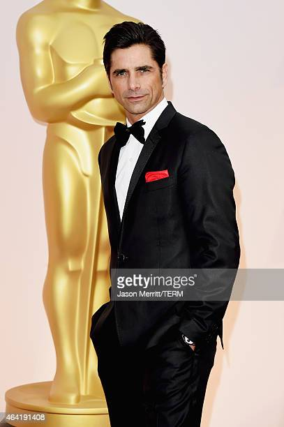 Actor John Stamos attends the 87th Annual Academy Awards at Hollywood Highland Center on February 22 2015 in Hollywood California