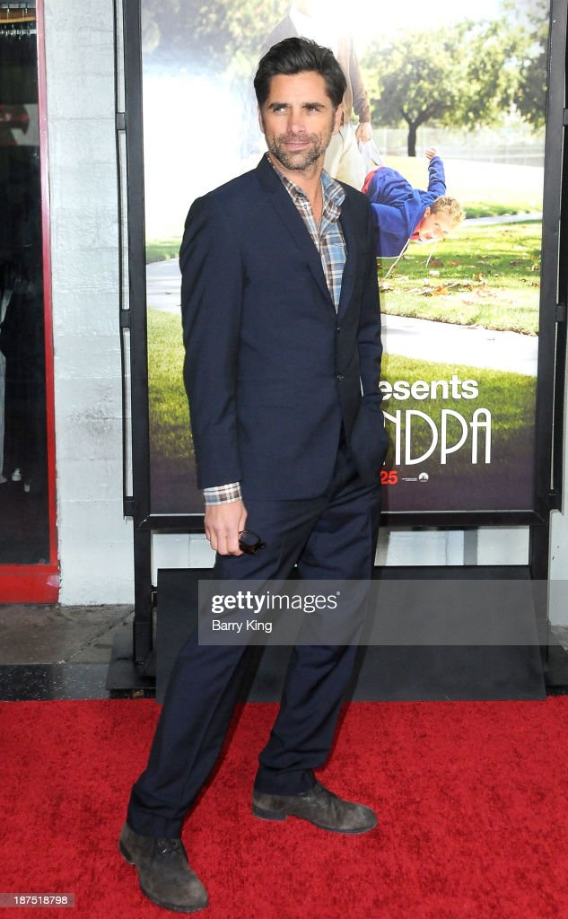 Actor <a gi-track='captionPersonalityLinkClicked' href=/galleries/search?phrase=John+Stamos&family=editorial&specificpeople=206285 ng-click='$event.stopPropagation()'>John Stamos</a> attends the Los Angeles premiere of 'Bad Grandpa: Presented by Jackass' on October 23, 2013 at TCL Chinese Theatre in Hollywood, California.