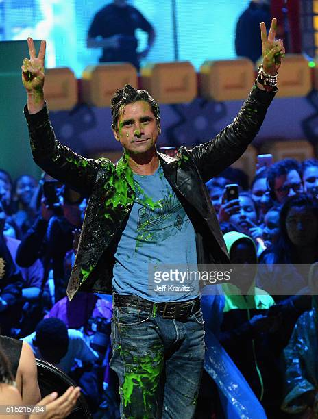 Actor John Stamos gets slimed during Nickelodeon's 2016 Kids' Choice Awards at The Forum on March 12 2016 in Inglewood California