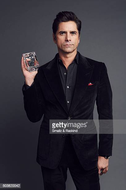 Actor John Stamos poses for a portrait at the 2016 People's Choice Awards at the Microsoft Theater on January 6 2016 in Los Angeles California