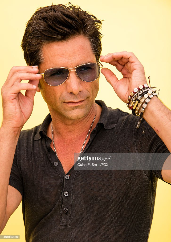 Actor John Stamos poses for a portrait during the 2015 Teen Choice Awards FOX Portrait Studio at Galen Center on August 16 2015 in Los Angeles...