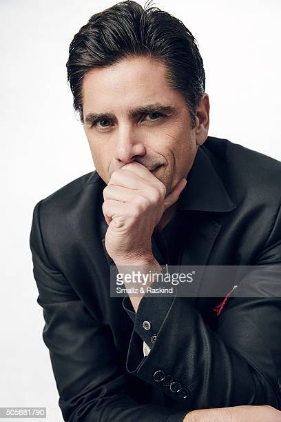 Actor John Stamos poses for a portrait during the 21st Annual Critics' Choice Awards at Barker Hangar on January 17 2016 in Santa Monica California