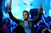 Actor John Stamos reacts after being slimed during Nickelodeon's 2016 Kids' Choice Awards at The Forum on March 12 2016 in Inglewood California