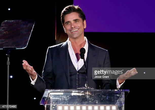 Actor John Stamos speaks onstage during the 4th Annual 'Reel Stories Real Lives' benefiting the Motion Picture Television Fund at Milk Studios on...