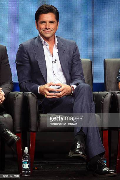 Actor John Stamos speaks onstage during the 'Grandfathered' panel discussion at the FOX portion of the 2015 Summer TCA Tour at The Beverly Hilton...