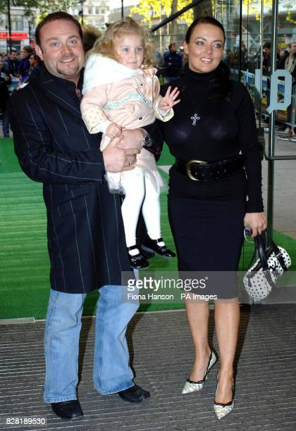 Actor John Thomson and wife Sam with their daughter Olivia two arrive for the UK premiere of 'Wallace Gromit The Curse of the WereRabbit' at the...