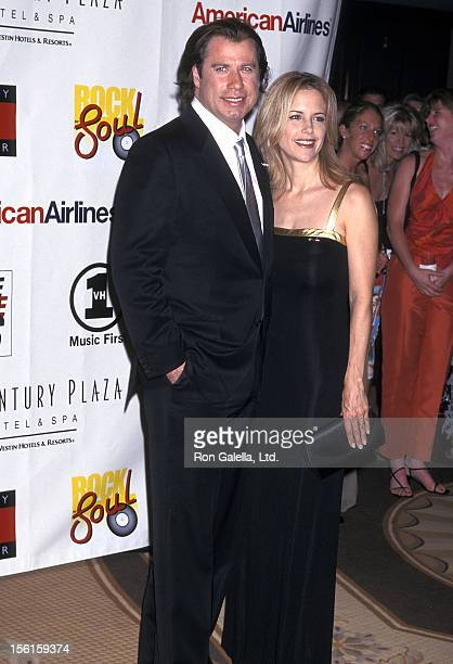 Actor John Travolt and actress Kelly Preston attend the Nancy Davis Foundation's Eighth Annual Race to Erase MS Gala on May 18 2001 at the Century...