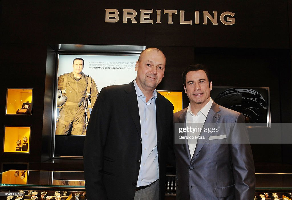 Actor <a gi-track='captionPersonalityLinkClicked' href=/galleries/search?phrase=John+Travolta&family=editorial&specificpeople=178204 ng-click='$event.stopPropagation()'>John Travolta</a> (R) and Thierry Prissert, Breitling USA President, pose during the Breitling Boutique Orlando Grand Opening Event on March 28, 2013 in Orlando, Florida.