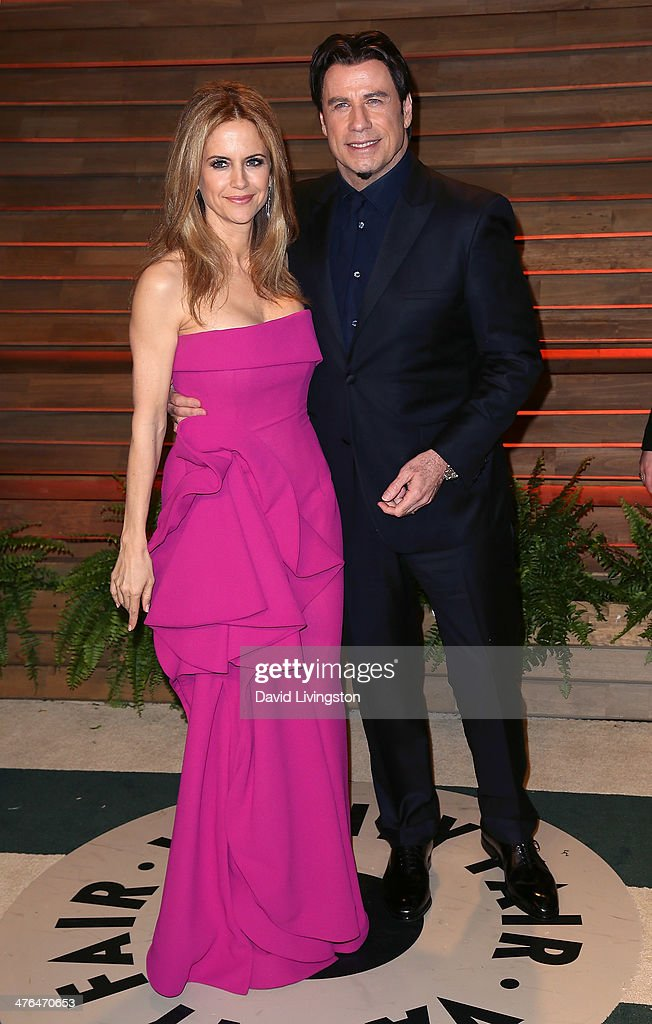 Actor John Travolta (R) and wife actress Kelly Preston attend the 2014 Vanity Fair Oscar Party hosted by Graydon Carter on March 2, 2014 in West Hollywood, California.