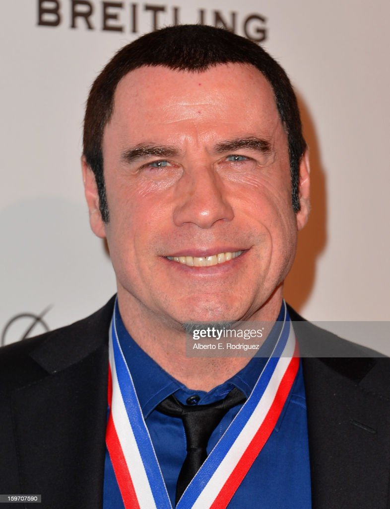 Actor <a gi-track='captionPersonalityLinkClicked' href=/galleries/search?phrase=John+Travolta&family=editorial&specificpeople=178204 ng-click='$event.stopPropagation()'>John Travolta</a> arrives to the 10th Annual Living Legends of Aviation Awards at The Beverly Hilton Hotel on January 18, 2013 in Beverly Hills, California.