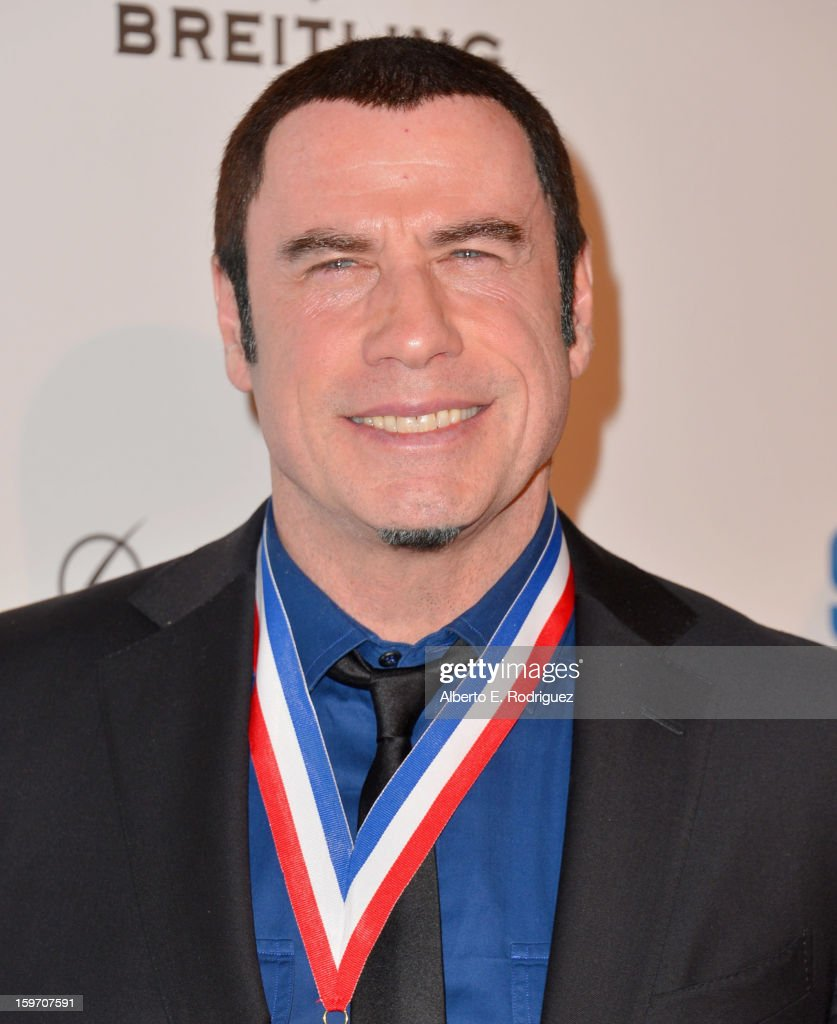 Actor John Travolta arrives to the 10th Annual Living Legends of Aviation Awards at The Beverly Hilton Hotel on January 18, 2013 in Beverly Hills, California.