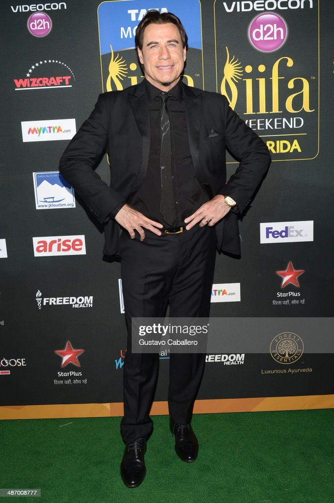 Actor <a gi-track='captionPersonalityLinkClicked' href=/galleries/search?phrase=John+Travolta&family=editorial&specificpeople=178204 ng-click='$event.stopPropagation()'>John Travolta</a> arrives to the IIFA Awards at Raymond James Stadium on April 26, 2014 in Tampa, Florida.