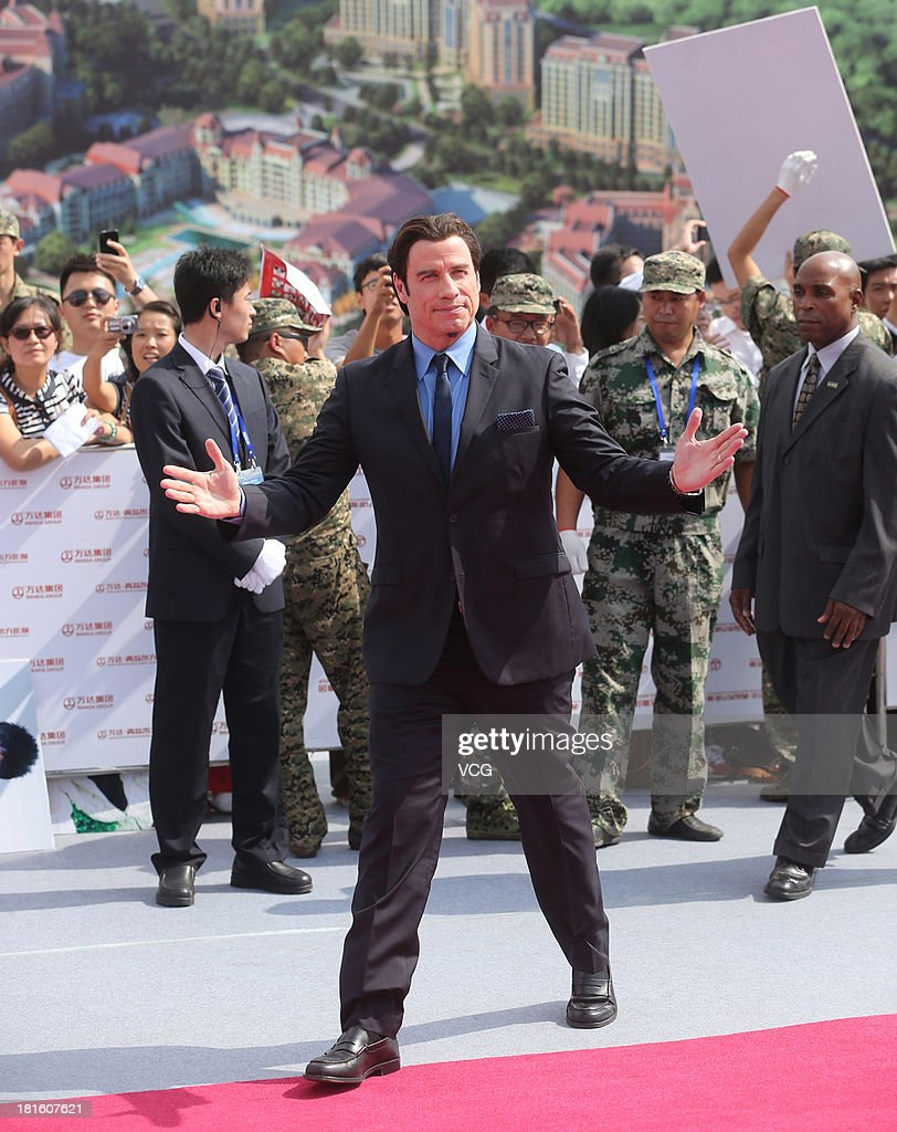 Actor <a gi-track='captionPersonalityLinkClicked' href=/galleries/search?phrase=John+Travolta&family=editorial&specificpeople=178204 ng-click='$event.stopPropagation()'>John Travolta</a> attends a launching ceremony for the Qingdao Oriental Movie Metropolis on September 22, 2013 in Qingdao, China.