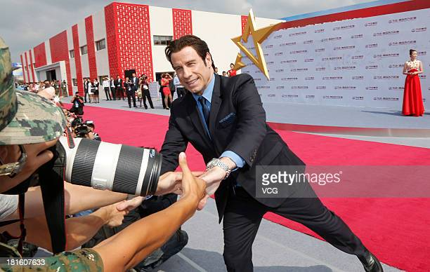 Actor John Travolta attends a launching ceremony for the Qingdao Oriental Movie Metropolis on September 22 2013 in Qingdao China