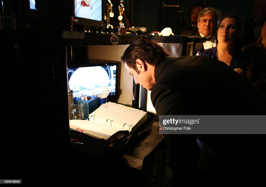 Actor <a gi-track='captionPersonalityLinkClicked' href=/galleries/search?phrase=John+Travolta&family=editorial&specificpeople=178204 ng-click='$event.stopPropagation()'>John Travolta</a> backstage during the Oscars held at the Dolby Theatre on February 24, 2013 in Hollywood, California.
