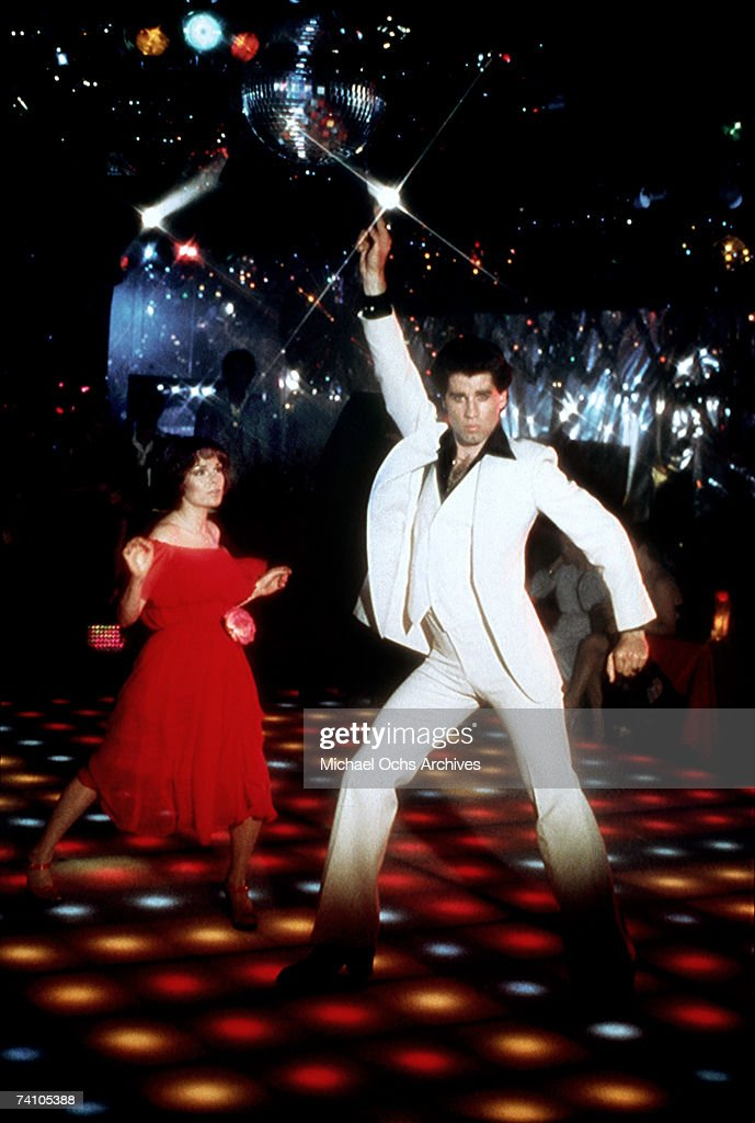 Actor John Travolta dances with Karen Lynn Gorney in scene from movie 'Saturday Night Fever' directed by John Badham.