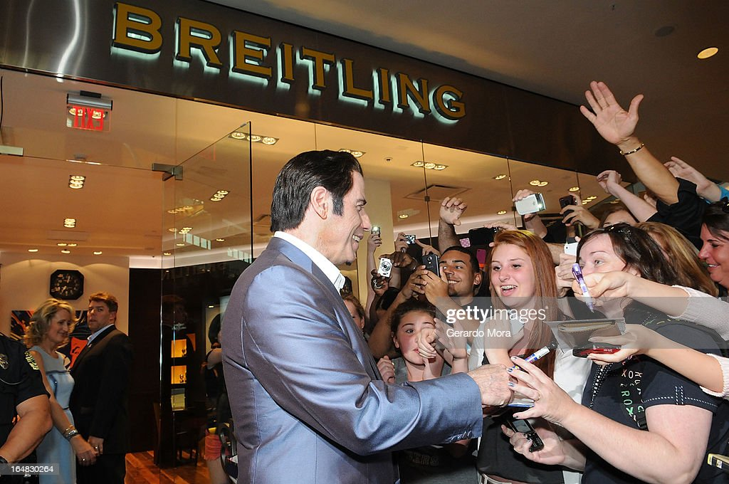 Actor <a gi-track='captionPersonalityLinkClicked' href=/galleries/search?phrase=John+Travolta&family=editorial&specificpeople=178204 ng-click='$event.stopPropagation()'>John Travolta</a> greets with people during the Breitling Boutique Orlando Grand Opening Event on March 28, 2013 in Orlando, Florida.
