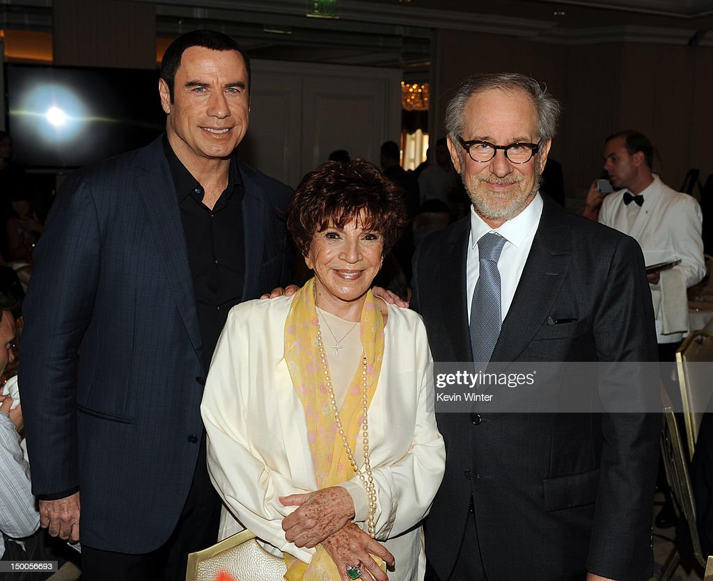 Actor <a gi-track='captionPersonalityLinkClicked' href=/galleries/search?phrase=John+Travolta&family=editorial&specificpeople=178204 ng-click='$event.stopPropagation()'>John Travolta</a>, HFPA President Dr. Aida Takla-O'Reilly and director <a gi-track='captionPersonalityLinkClicked' href=/galleries/search?phrase=Steven+Spielberg&family=editorial&specificpeople=202022 ng-click='$event.stopPropagation()'>Steven Spielberg</a> attend the Hollywood Foreign Press Association's 2012 Installation Luncheon held at the Beverly Hills Hotel on August 9, 2012 in Beverly Hills, California.