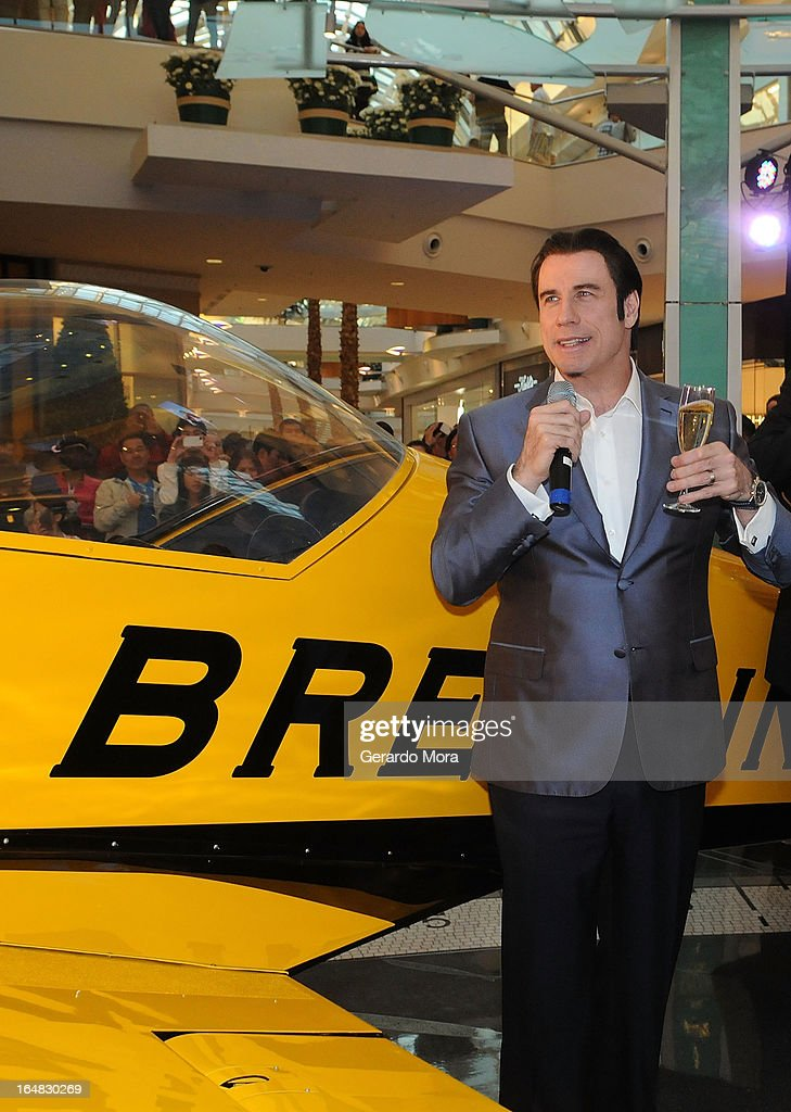 Actor <a gi-track='captionPersonalityLinkClicked' href=/galleries/search?phrase=John+Travolta&family=editorial&specificpeople=178204 ng-click='$event.stopPropagation()'>John Travolta</a> (L) makes a toast during the Breitling Boutique Orlando Grand Opening Event on March 28, 2013 in Orlando, Florida.