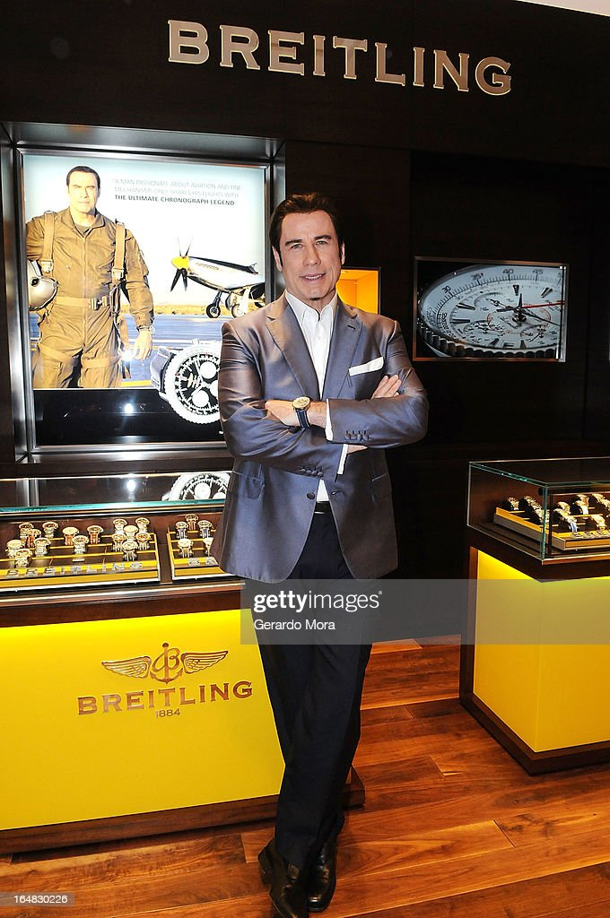 Actor <a gi-track='captionPersonalityLinkClicked' href=/galleries/search?phrase=John+Travolta&family=editorial&specificpeople=178204 ng-click='$event.stopPropagation()'>John Travolta</a> poses during the Breitling Boutique Orlando Grand Opening Event on March 28, 2013 in Orlando, Florida.