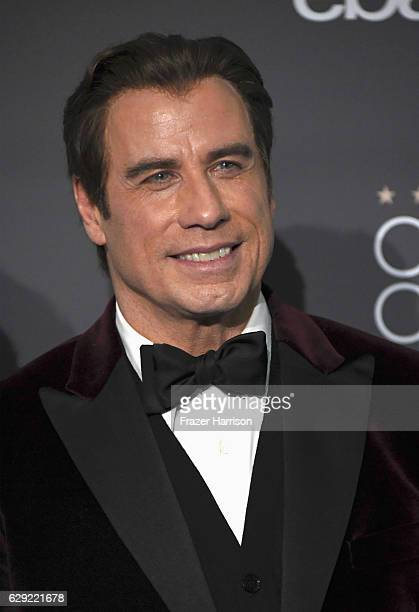 Actor John Travolta poses in the press room during The 22nd Annual Critics' Choice Awards at Barker Hangar on December 11 2016 in Santa Monica...