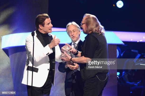 Actor John Travolta President/CEO of The Recording Academy and GRAMMY Foundation President/CEO Neil Portnow and honoree Barry Gibb speak onstage...
