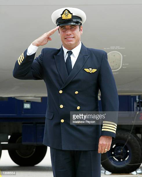 Actor John Travolta salues after arriving in his Quantas 707 'Jett Clipper Ella' on the final stop of his round the globe 'Spirit Of Friendship' tour...