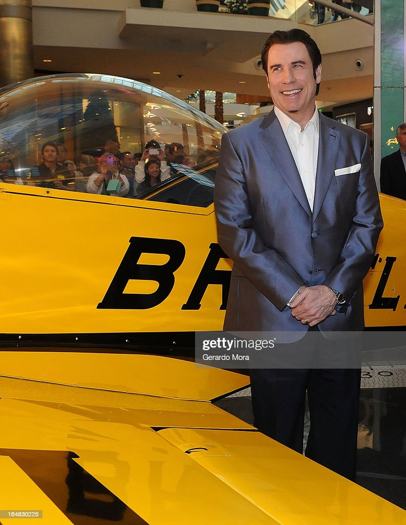 Actor John Travolta smiles during the Breitling Boutique Orlando Grand Opening Event on March 28, 2013 in Orlando, Florida.