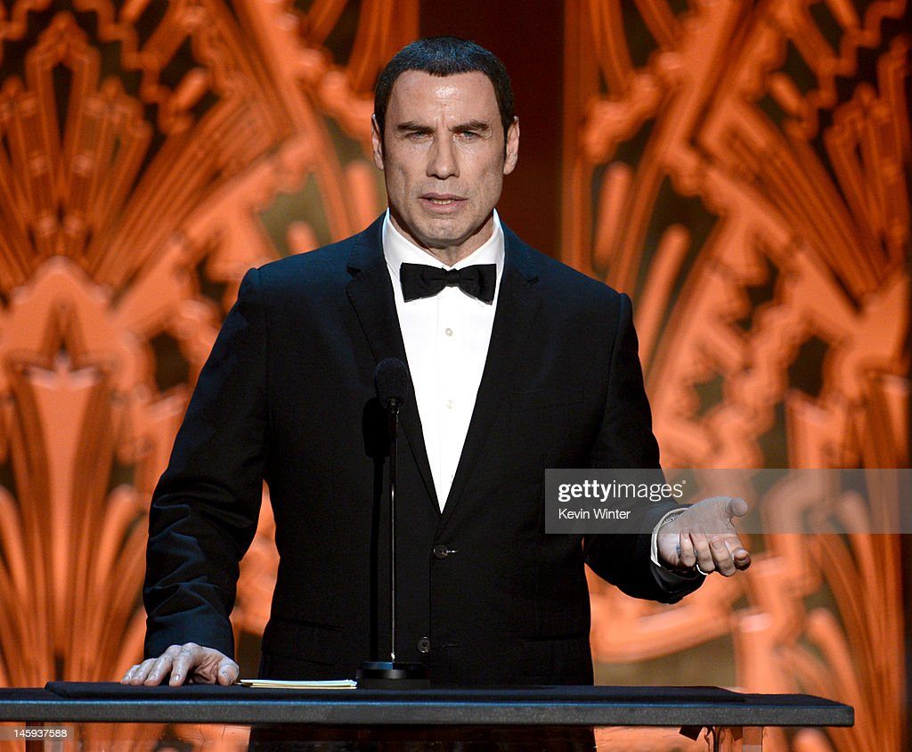 Actor John Travolta speak onstage at the 40th AFI Life Achievement Award honoring Shirley MacLaine held at Sony Pictures Studios on June 7, 2012 in Culver City, California. The AFI Life Achievement Award tribute to Shirley MacLaine will premiere on TV Land on Saturday, June 24 at 9PM