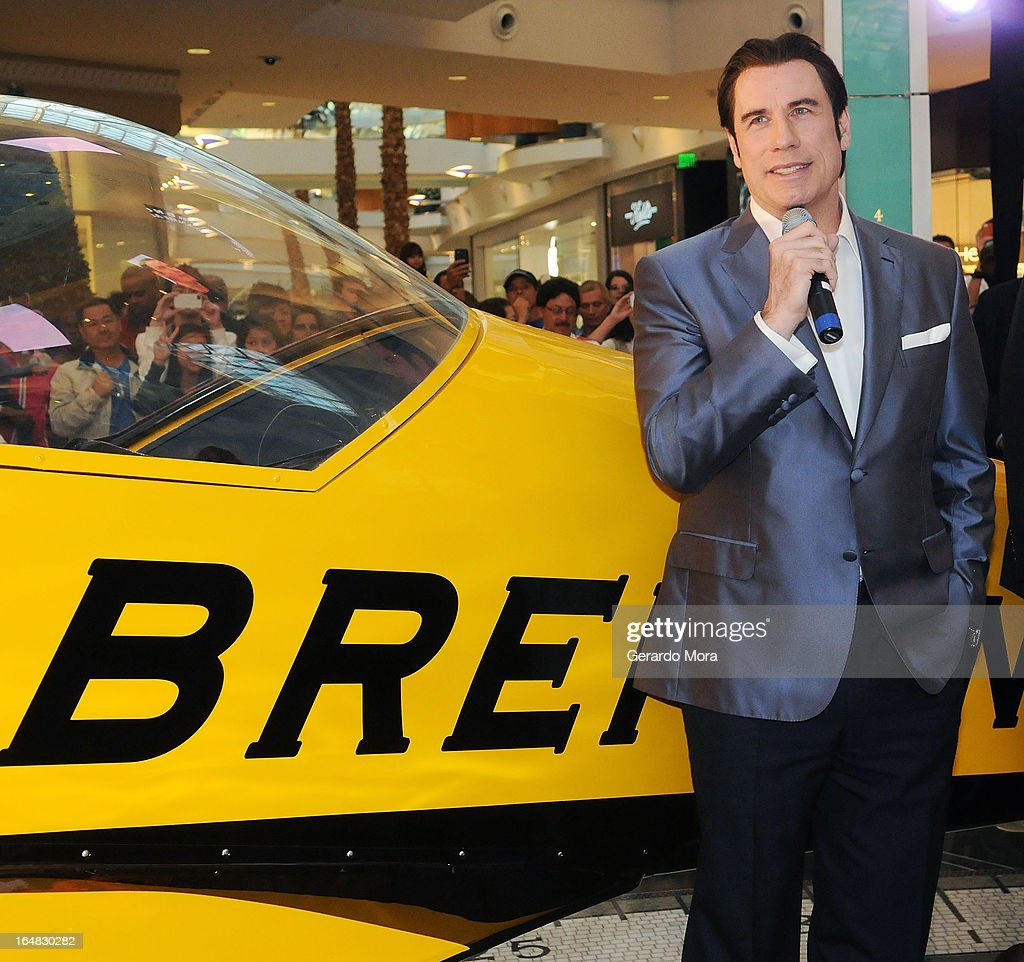 Actor <a gi-track='captionPersonalityLinkClicked' href=/galleries/search?phrase=John+Travolta&family=editorial&specificpeople=178204 ng-click='$event.stopPropagation()'>John Travolta</a> (L) speaks during the Breitling Boutique Orlando Grand Opening Event on March 28, 2013 in Orlando, Florida.