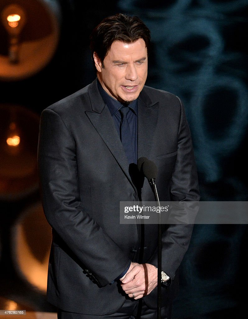 Actor <a gi-track='captionPersonalityLinkClicked' href=/galleries/search?phrase=John+Travolta&family=editorial&specificpeople=178204 ng-click='$event.stopPropagation()'>John Travolta</a> speaks onstage during the Oscars at the Dolby Theatre on March 2, 2014 in Hollywood, California.