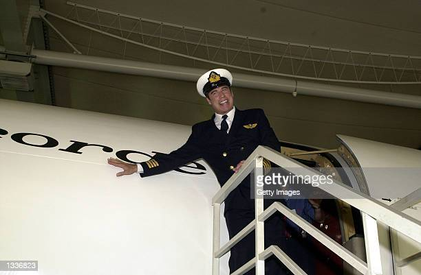 Actor John Travolta who recently completed a pilot training course with airline Qantas poses in uniform August 13 2002 in Le Bourget France The...