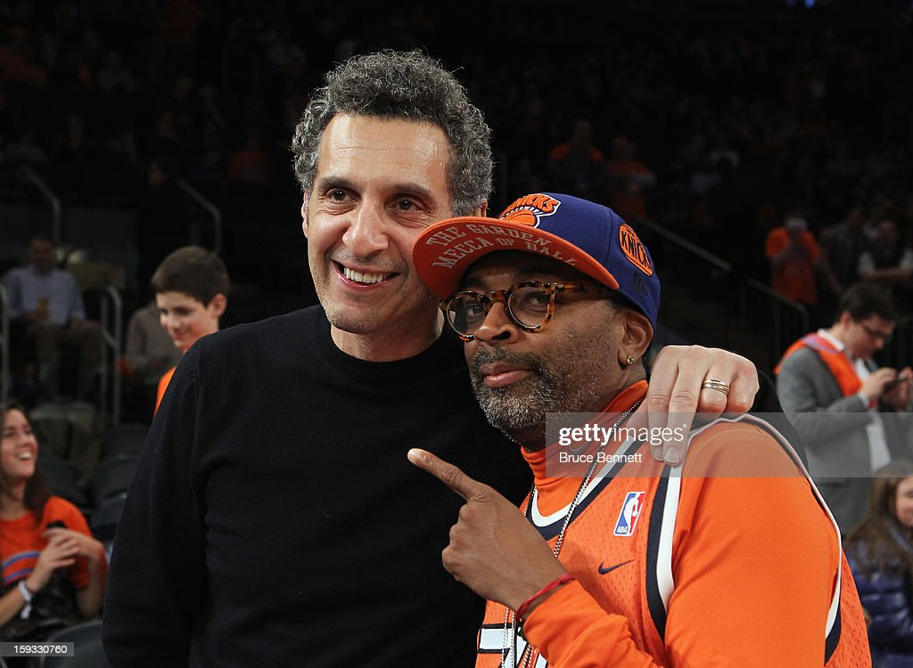 Actor John Turturro and Director Spike Lee pose for photos prior to the game between the New York Knicks and the Chicago Bulls at Madison Square Garden on January 11, 2013 in New York City.