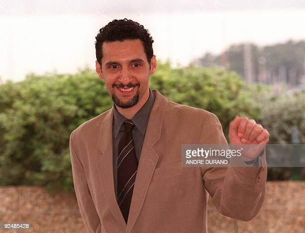 US actor John Turturro as he poses for photographers 13 May at the festivals Palace for the presentation of Francesco Rosi's film 'La Tregua' adapted...