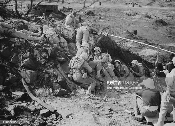 Actor John Wayne preparing for a scene from the 1949 war film 'Sands of Iwo Jima' directed by Allan Dwan and starring amongst others John Agar Forest...