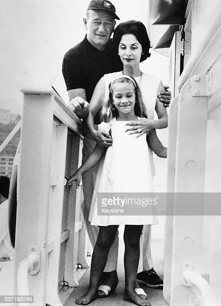 Actor John Wayne with his wife Pilar Pallete and daughter Aissa in Monte Carlo following sailing the Atlantic Monaco August 29th 1963