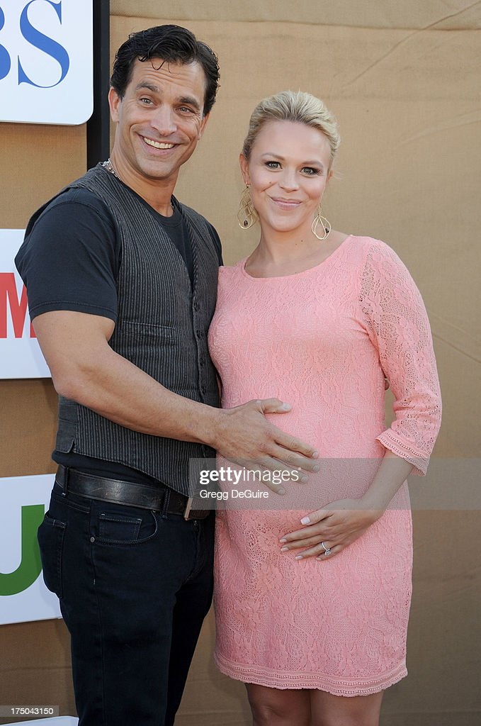 Actor Johnathon Schaech and Julie Solomon arrive at the CBS/CW/Showtime Television Critic Association's summer press tour party at 9900 Wilshire Blvd on July 29, 2013 in Beverly Hills, California.