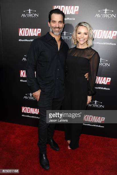 Actor Johnathon Schaech and wife Julie Solomon attend the premiere of 'Kidnap' at ArcLight Hollywood on July 31 2017 in Hollywood California